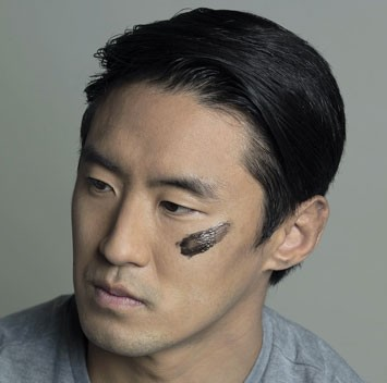 Man mearing Lumin skin care product