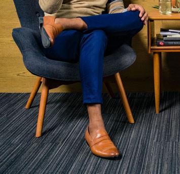 Man wearing tan loafers