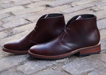 Brown chukkas on brick street