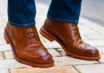 Brown wingtips and blue jeans