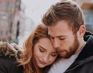 Couple hugging intimately