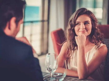 Woman looking at man with interest
