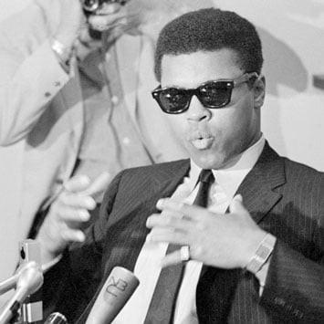 Muhammad Ali wearing Ray Ban Sunglasses