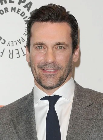 Jon Hamm with tapered hair and grey suit