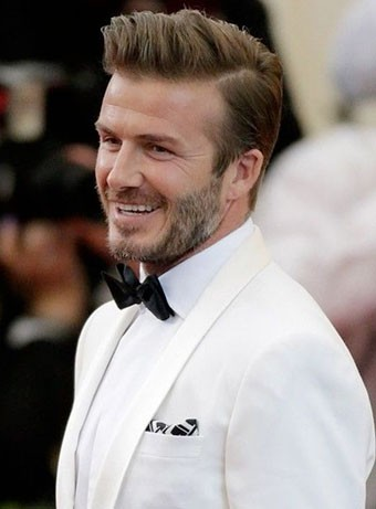 David Beckham in a white tuxedo with tapered hair