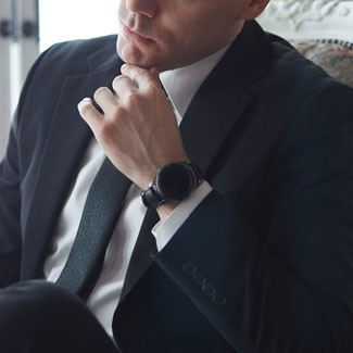 Man in suit wearing smart watch