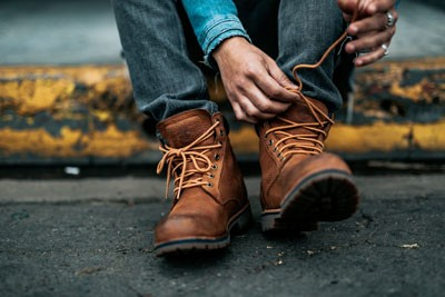 Man tying men's work boots