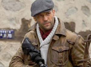 Jason Statham wearing a newsboy cap in The Expendables