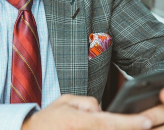 Man with pocket square using phone