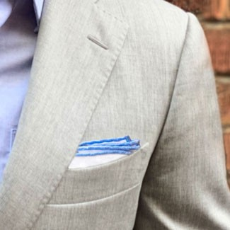Grey suit, blue shirt and pocket square