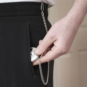 Man putting pocket watch in front pocket