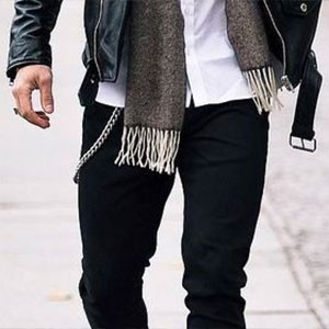 Man wearing pocket watch chain and leather jacket