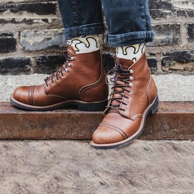 Man wearing brown cap toe boots