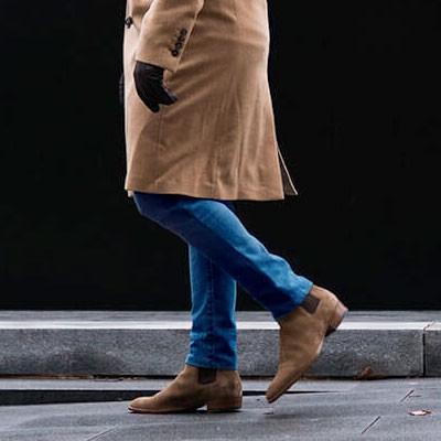 Man wearing beige Chelsea boots