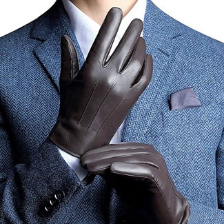 Man in blue suit pulling on leather gloves