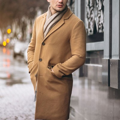 Man wearing camel top coat
