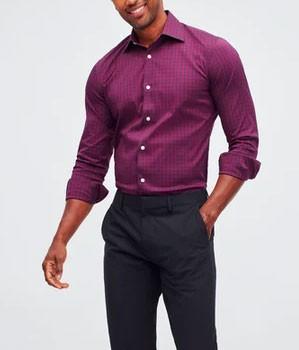 Man wearing burgundy colored shirt tucked into dark pants