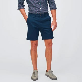 Man with blue shorts and grey shoes