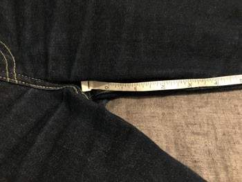 Measuring tape starting at bottom of crotch