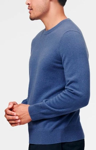 The Naadam Cashmere Essential Sweater in blue shown from the side