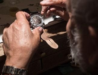 Man assembling Vincero watch