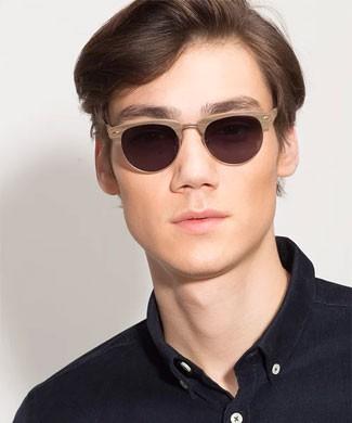 Man wearing wooden sunglasses