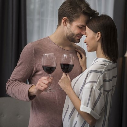 This or That Questions Dirty - Intimate couple holding wine glasses