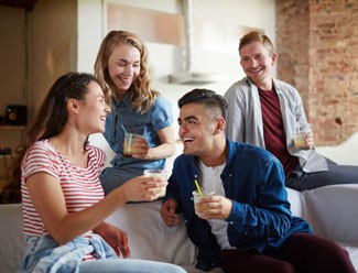 Group of friends laughing and talking