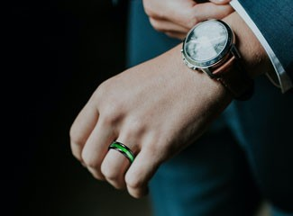 Man wearing green unique wedding ring