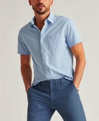 Man in light blue short sleeved summer shirt