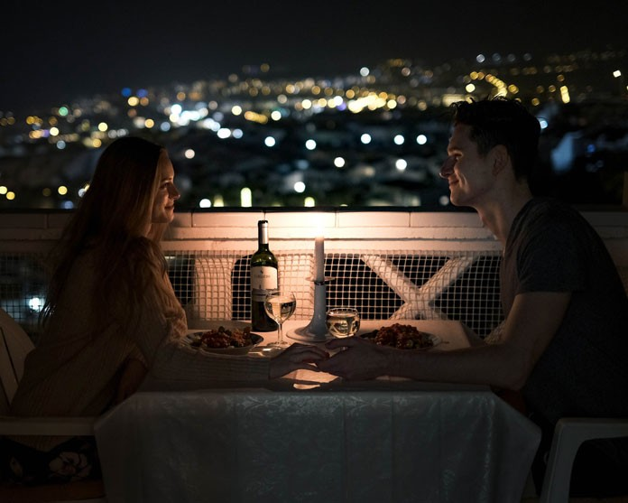 Young couple having dinner outside