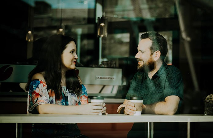 New couple having conversation in coffee shop