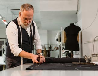 Personal clothier cutting fabric