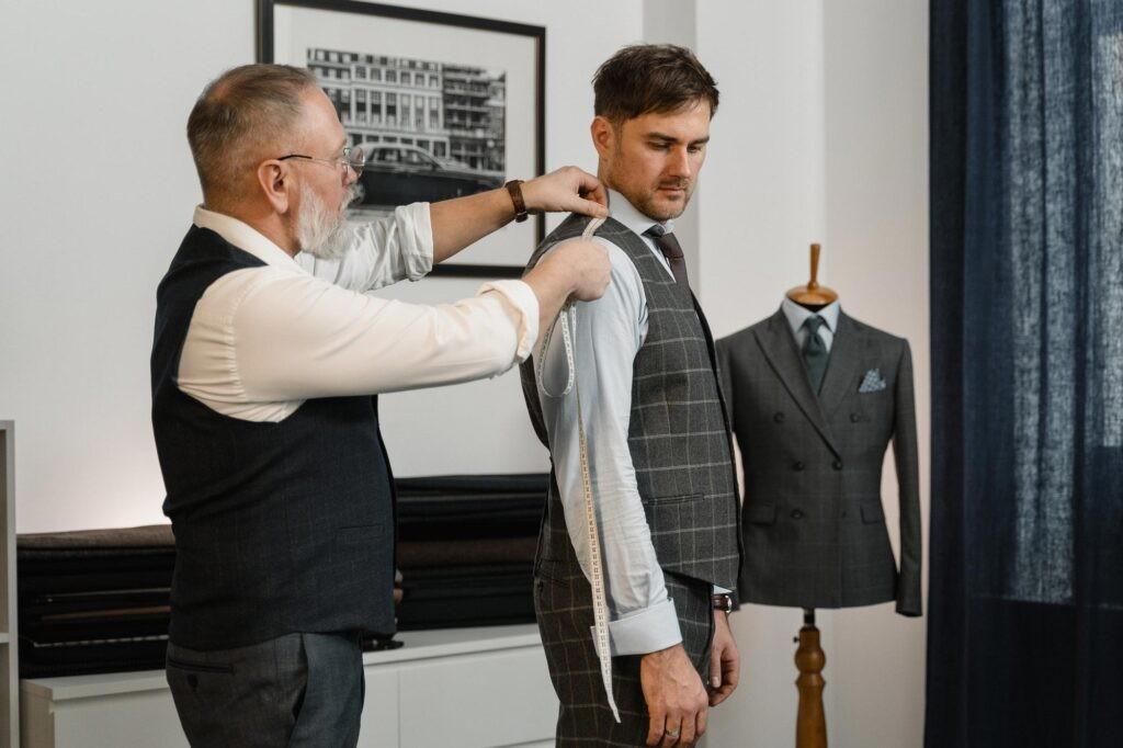 A professional clothier measuring a man's arm
