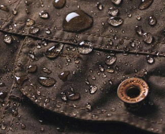Water droplets on The Taylor Stitch Long Haul Jacket