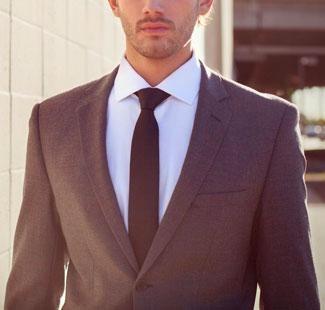 Man wearing Alain Dupetit suit at dusk