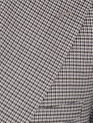 Close up of houndstooth pattern on suit