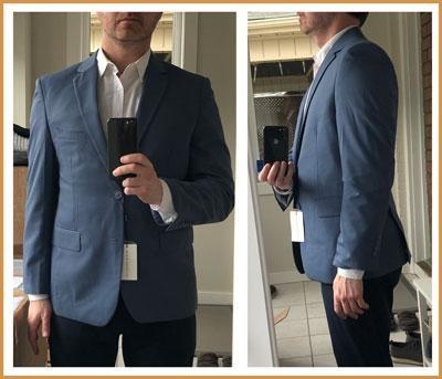 Blue Alain Dupetit suit in the mirror