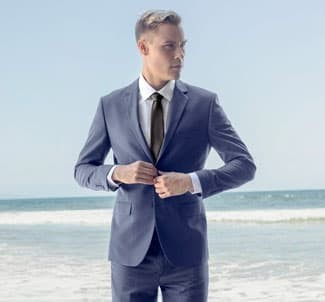 Alain Dupetit suit at beach