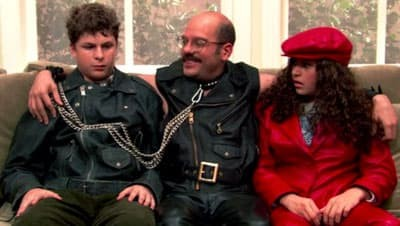 Tobia Funke wearing leather outfit