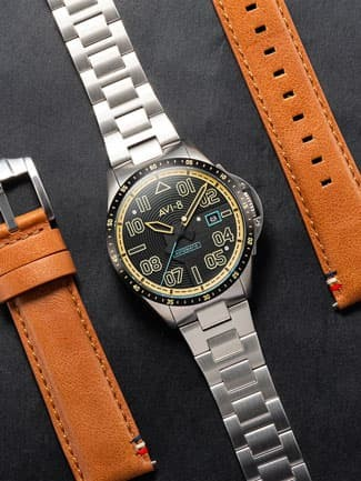 the Jubilee Automatic Limited Edition Reigate from AVI-8 next to leather watch straps