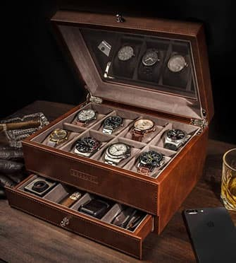 brown leather watch box full of watches